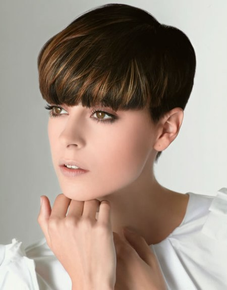 Short Pixie Cut With Thick Bangs That Compliment The Face
